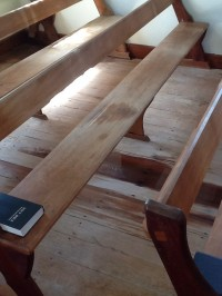 Water Damage to the Pews and Floors