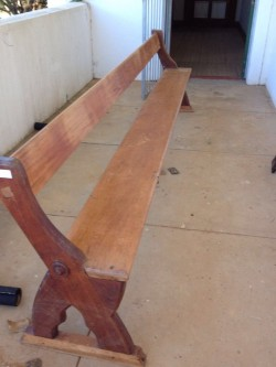 A Water Damaged Yellowwood Pew